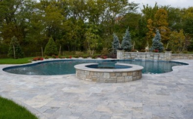 Freeform gunite pool with spillover spa